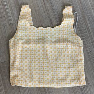 yellow scalloped patterned top